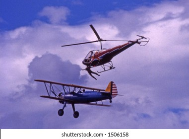 helicopter 'rescues' man from wing of biplane
