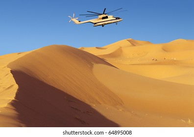 Helicopter rescuing tourists lost among dunes