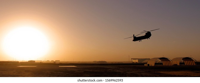 Helicopter silhouette whilst flying towards the sun
