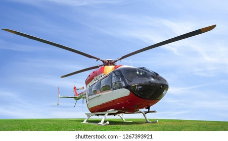 helicopter standing on green grass field, isolated on white background, big size, nobody