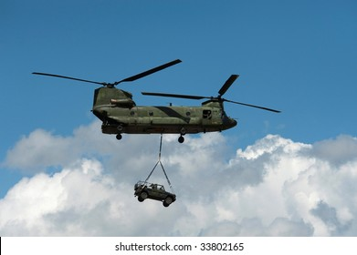 a helicopter transports a jeep