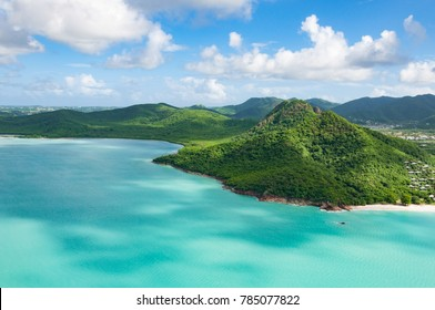 Helicopter view to the Caribbean island Antigua with mountains and rainforest