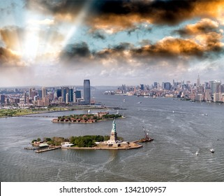 Helicopter view of Statue of Liberty with Lower Manhattan and Jersey City in the background, New York City.