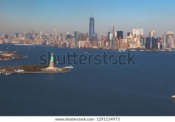 Helicopter view of statue of liberty on background downtown Manhattan . Aerial view. Liberty IslandManhattan, New York City, New York.