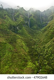 A helicopter view of waterfalls draining from the lush south side of Mount Waialeale (Wai'ale'ale), Kauai. This wilderness area is considered one of the wettest or rainiest spot on earth.