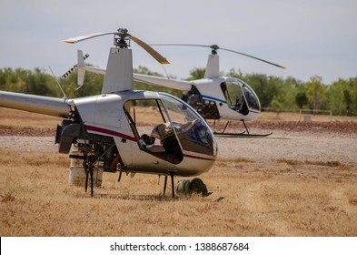 Helicopters parked up after the muster on an Outback cattle station in Western Australia - Shutterstock ID 1388687684