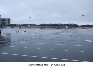 Helicopters are parked at the airport
