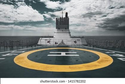 Helipad on board a Ship against a grey Sea