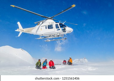 Heli-Skiing group with helicopter in Monte Rosa region