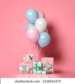 Helium inflatable latex pastel color light blue pink white balloons and present gifts background for decorations on birthday wedding corporative party