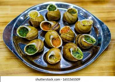 Helix Aspersa Muller, Maxima snail.  Edible snails with butter and seasonings.