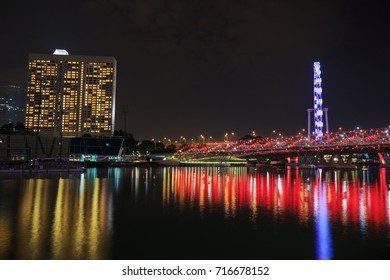 The Helix Bridge in Singapore city at night