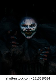 Hellga Scary Clown Hiding Under Dark Train with Hands Coming out