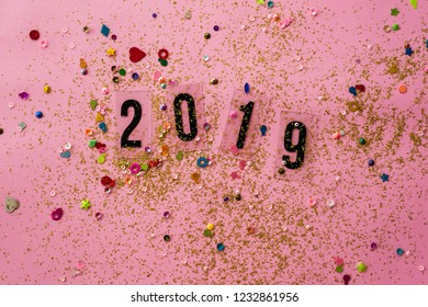 hello 2019 with glitter, on pink background