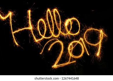 Hello 2019 written with a sparkler on a black background