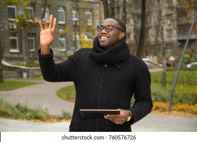 Hello! African american man making a greeting gesture. Say hello or say goodbye to someone.