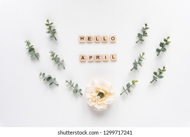 Hello April words on white marble background