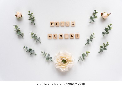 Hello August words on white marble background