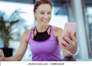 Hello darling. Selective focus of innovative phone hold by happy woman who calling online