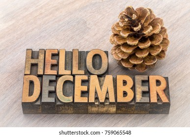 Hello December greeting card - vintage letterpress wood type blocks against grained wood