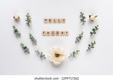 Hello Friday words on white marble background
