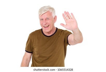 Hello! A happy middle aged man shows his hand a greeting sign.