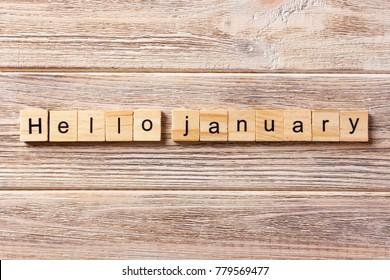 hello january word written on wood block. hello january text on table, concept.