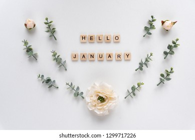 Hello January words on white marble background