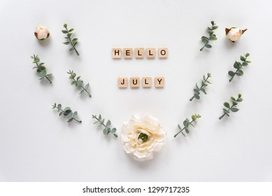 Hello July  words on white marble background
