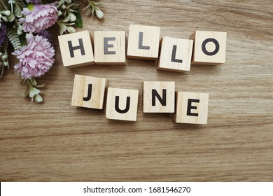Hello June alphabet letters on wooden background