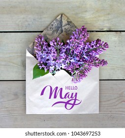 Hello May hand lettering card. Spring lilac flowers in envelope.
