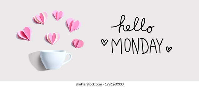 Hello Monday message with a coffee cup and paper hearts - flat lay