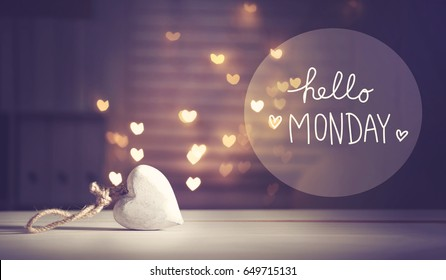 Hello Monday message with a white heart with heart shaped lights