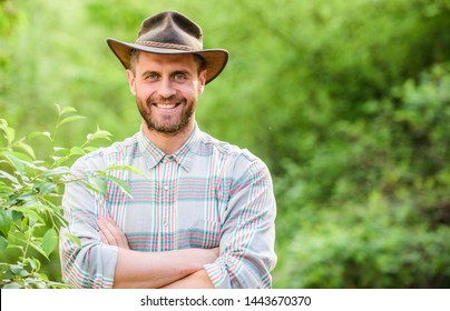 Hello. muscular ranch man in cowboy hat care plants. Eco farm worker. Harvest. happy earth day. Eco living. farming and agriculture cultivation. Gardening ranch. successful sexy farmer.