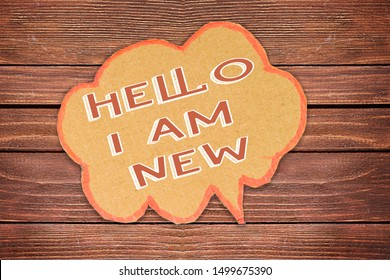 hello i am new concept on speech bubble on wood background