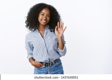 Hello nice meet you. Portrait pleasant friendly charming african american female office newbie getting know coworker waving hi greeting gesture, smiling happily, expressing pleasant positive vibe