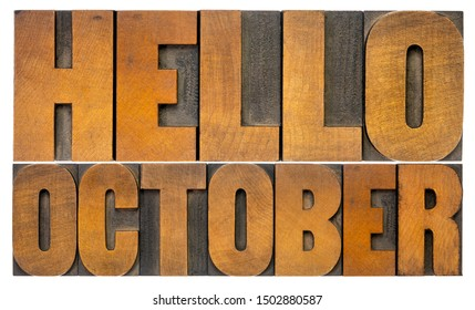 Hello October - cheerful word abstract in vintage letterpress wood type blocks isolated on white,