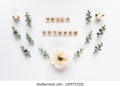 Hello October words on white marble background