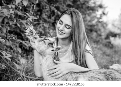 Hello pets. woman vet feeding goat. farm and farming concept. Animals are our friends. happy girl love goat. village weekend. summer day. Love and protect animals. contact zoo. veterinarian lamb goat.