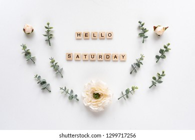 Hello Saturday words on white marble background