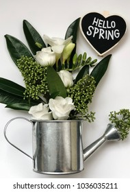 hello spring chalkboard with white eustoma and other flowers. spring flower flat lay