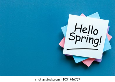 Hello Spring - note at work place with empty space for text, mockup or template. spring time beginning