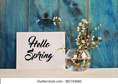 Hello spring poster and bouquet of cherry flowers
