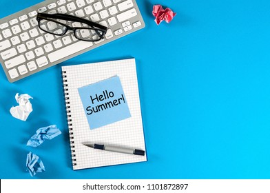 Hello Summer - inscription at notes on blue office background. First summer day, Calendar concept. With copy space for text