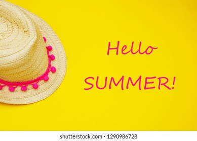 Hello summer words. Yellow Straw Hat over Summer Yellow Background Holliday concept.