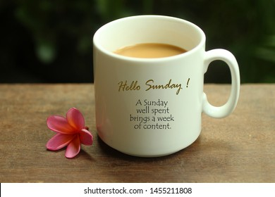 Hello Sunday greetings and quote on white mug of coffee - A Sunday well spent brings a week of content. Morning coffee. Sunday white coffee concept with text notes, self reminder on a mug.