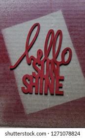 Hello Sunshine spray painted on cardboard