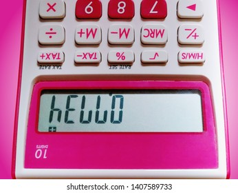 Hello Text on LCD Display of Pink 10-Digit Calculator Viewing Up Side Down