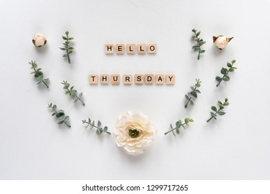 Hello Thursday words on white marble background