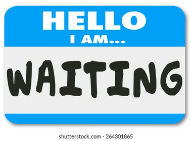Hello I Am Waiting words on a nametag sticker to illustrate being patient, late, tardy or delayed for a trip, appointment, meeting or event